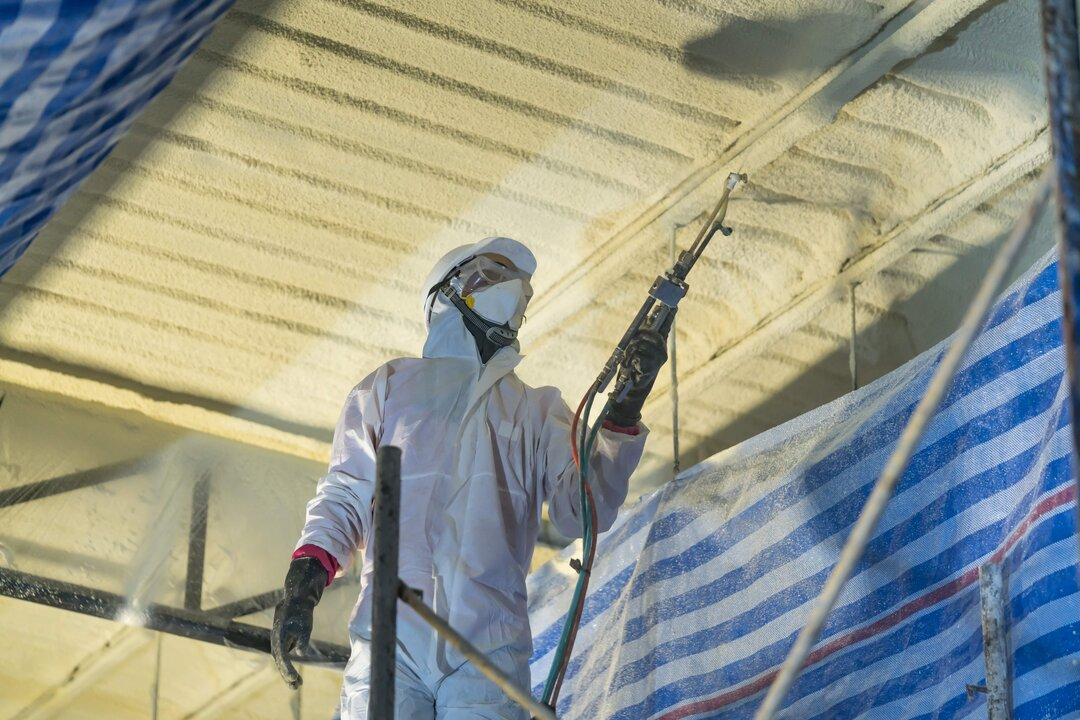Technician Spraying Foam Insulation